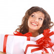 Stock Photo: Excited attractive womwith many gift boxes and bags