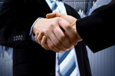 Handshake and diagram — Stock Photo