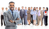 Leader and her team, Young attractive business with focus only on businesswoman in the middle — Stock Photo