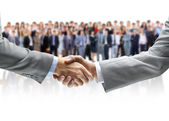 Shaking hands and business team — Stok fotoğraf