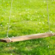 Empty Wooden Swing in the Garden - Stock Photo