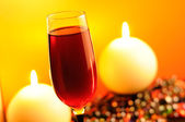 Romantic Evening - Glass of Red Wine and Burning Candles — Stock Photo