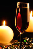 Romantic Dinner - Glass of Red Wine and Burning Candles — Stock Photo