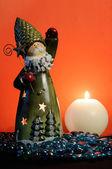 Santa Claus Candle Holder and Burning Candle on Orange Background — Stock Photo