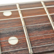 Electric Guitar Fingerboard (Fretboard) with Strings Close-up — Stok fotoğraf