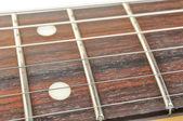 гриф гитары (гриф) с строки макро — Стоковое фото