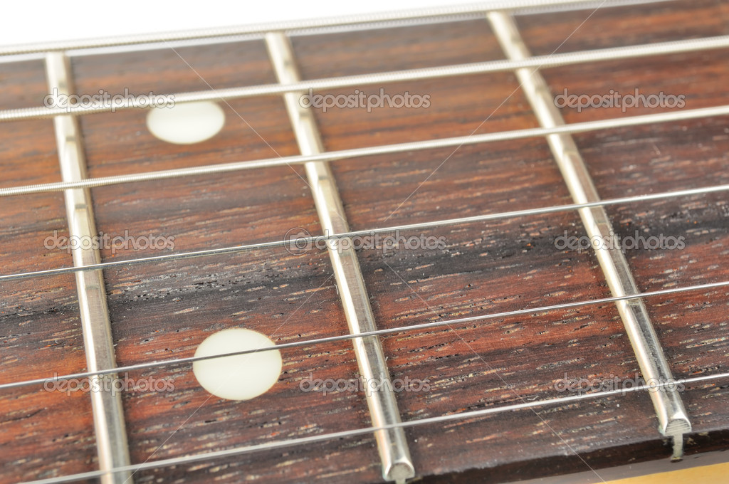 A close-up of an electric guitar fingerboard (fretboard) with strings  — Stock Photo #8265546