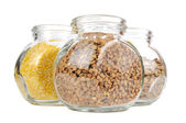 Glass Jars with Buckwheat, Corn Grits and Lentils — Stock Photo