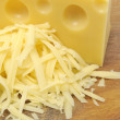 Grated Cheese and Chunk of Cheese — Stock Photo #8638186