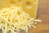 Grated Cheese and Chunk of Cheese — Stock Photo