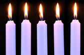Five Burning Candles on Black Background — Stock Photo