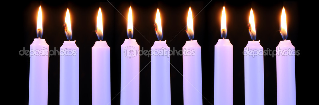 Nine burning candles on a black background — Stock Photo #9042827