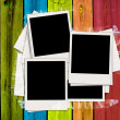 blank photos on multicolored wood plank background — Stock Photo