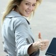 Girl using laptop while sitting on bench at spring park — Stock Photo #10503570