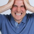Caucasian man clenches teeth in anger — Stock Photo #10503687