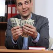 Man with dollars in their hands — Stock Photo #10503703