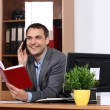Stock Photo: Smiling man talking on mobile phone