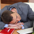 A man sleeping on the job — Stock Photo