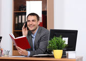 Smiling man talking on mobile phone — Stock Photo