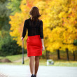 Stock Photo: Walking womred skirt