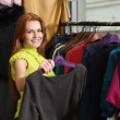 Young woman trying on dress - Foto de Stock  
