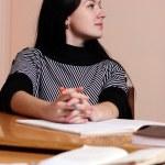Female teacher in classroom — Stock Photo