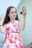 Little girl look at mirror — Stock Photo