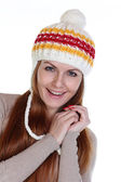 Happy woman in a knitted hat — Stock Photo