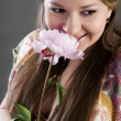 Portrait of beautiful young woman with flower — Stock Photo