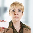 Portrait of business woman giving blank business card. — Stock Photo #10527049