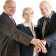 Stock Photo: Business hands making a pile