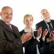 Three business team standing in a row and clapping — Stock Photo