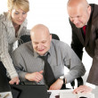 Three business working at meeting — Stock Photo #10527213