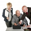 Three business working at meeting — Stockfoto