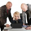 Three business working at meeting - Stock Photo