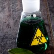 Medical tube with symbol biohazard - Stock Photo