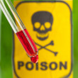 Poison bottle with label and blood — Stock Photo