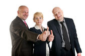 Group of business standing with thumbs up sign — Stock Photo