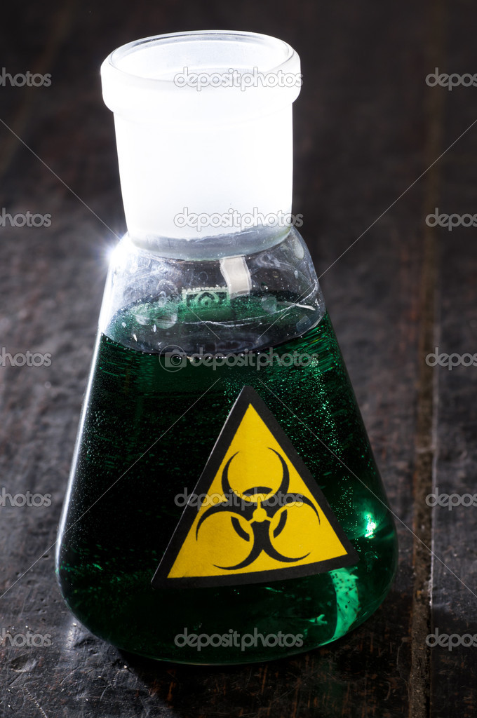 Medical tube with symbol biohazard — Stock Photo #10527372