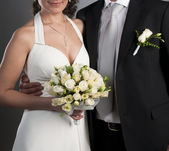 Groom and bride with a wedding bouquet — Stockfoto