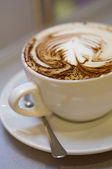 Cup of capuccino — Stock Photo