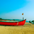Boat on the Mandrem beach in Goa - Stock Photo