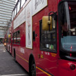 Double Decker red bus  rides on the street in  London - Stok fotoğraf
