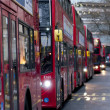 Double Decker red bus  rides on the street in  London — Stock Photo