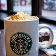 Starbucks cup of coffee in coffeehouse — Stock Photo #9911749