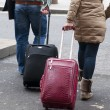 Travelers with suitcases — Stock Photo
