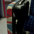 Suitcase in a fast modern train - Stock Photo