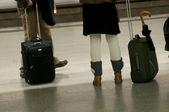 Travelers waiting train — Stock Photo