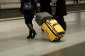Travelers in motion rushing through an platform — Stock Photo