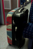 Suitcase in a fast modern train — Stock Photo